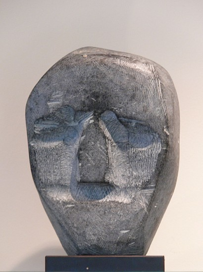 John Kavik ,   Head  ,  1985-1990     Stone ,  6 x 4 1/4 x 2 in.     This dramatic head epitomizes Kavik's style.  Kavik has created a commanding visage with minimal details.  The eyes and mouth are gouged out, leaving a prominent nose.  The surface bears chisel marks all over.  It was included in an exhibit entitled